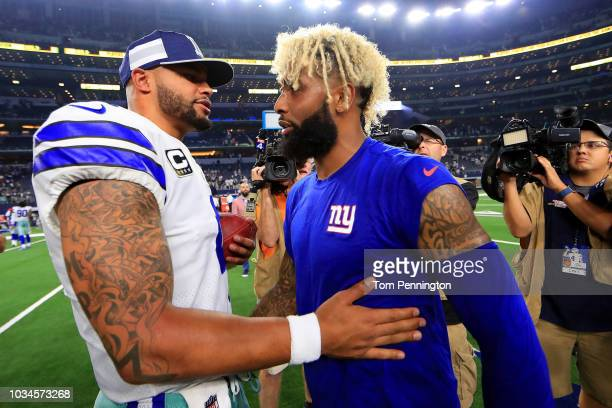 Dak Prescott of the Dallas Cowboys greets Odell Beckham Jr #13 of the New York Giants after the Dallas Cowboys beat the New York Giants 2013 at ATT...