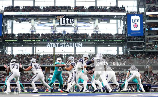 Dak Prescott of the Dallas Cowboys hands the ball off to Ezekiel Elliott of the Dallas Cowboys in action against the Miami Dolphins in the first half...