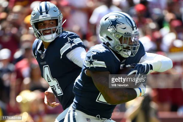 Dak Prescott of the Dallas Cowboys hands the ball off to Ezekiel Elliott during the first half against the Washington Redskins at FedExField on...