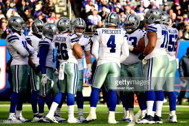 Dak Prescott of the Dallas Cowboys huddles with his team prior to the play against the New York Giants at MetLife Stadium on December 30 2018 in East...
