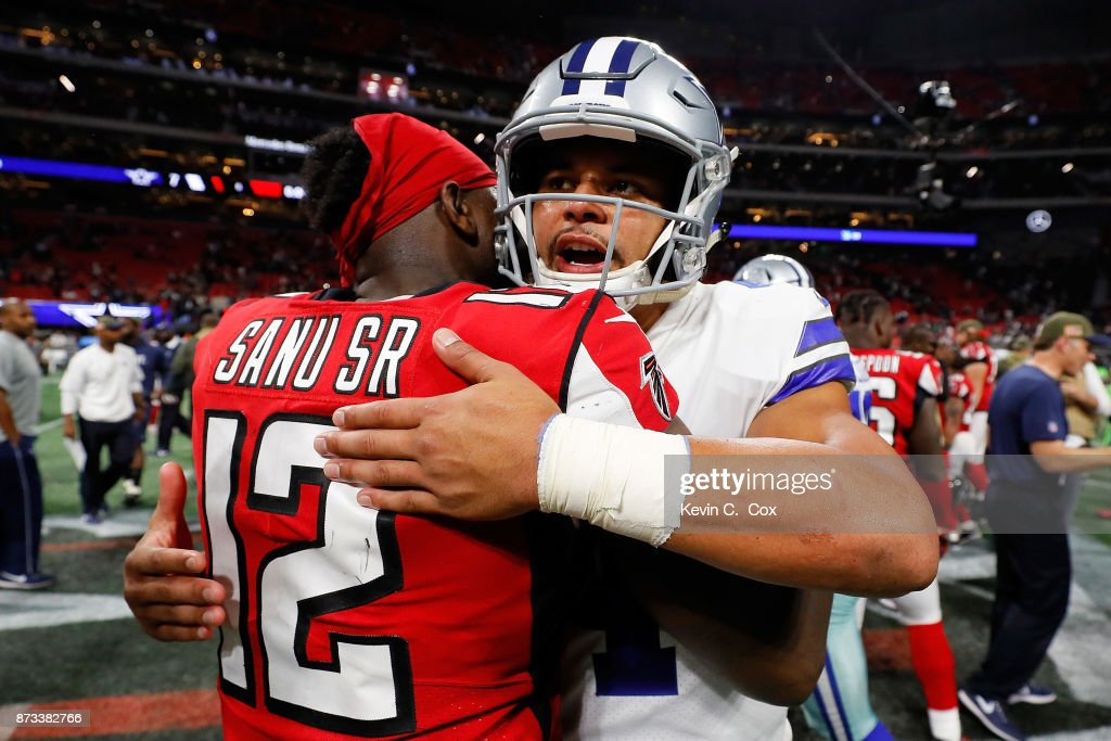 Dak Prescott #4 of the Dallas Cowboys hugs Mohamed Sanu #12 of the Atlanta Falcons after the game at Mercedes-Benz Stadium on November 12, 2017 in Atlanta, Georgia.