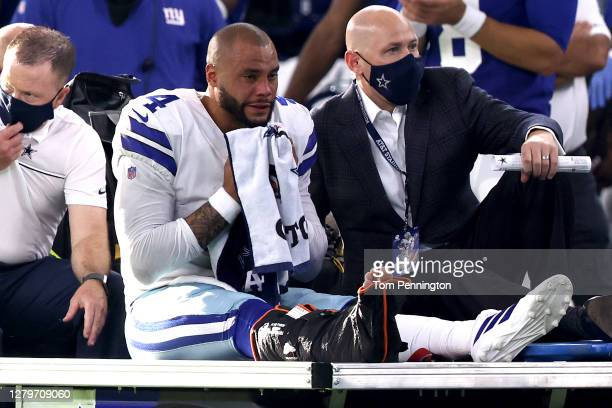 Dak Prescott of the Dallas Cowboys is carted off the field after sustaining a leg injury against the New York Giants during the third quarter at AT&T...