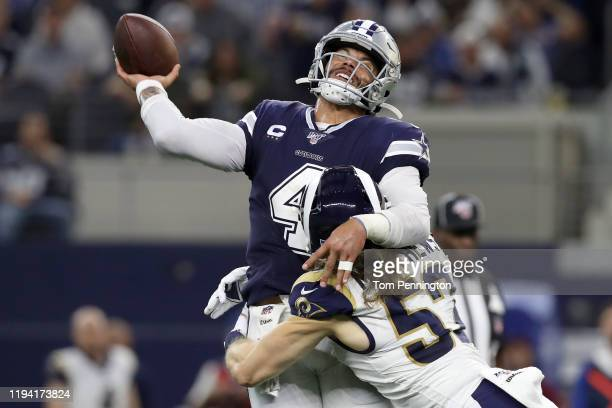 Dak Prescott of the Dallas Cowboys is hit by Clay Matthews of the Los Angeles Rams in the second quarter at ATT Stadium on December 15 2019 in...