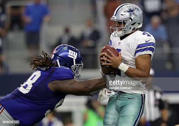 Dak Prescott of the Dallas Cowboys is hit by Damon Harrison of the New York Giants during the second half at ATT Stadium on September 11 2016 in...