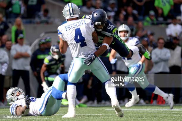 Dak Prescott of the Dallas Cowboys is hit by Mychal Kendricks of the Seattle Seahawks in the second quarter during their game at CenturyLink Field on...