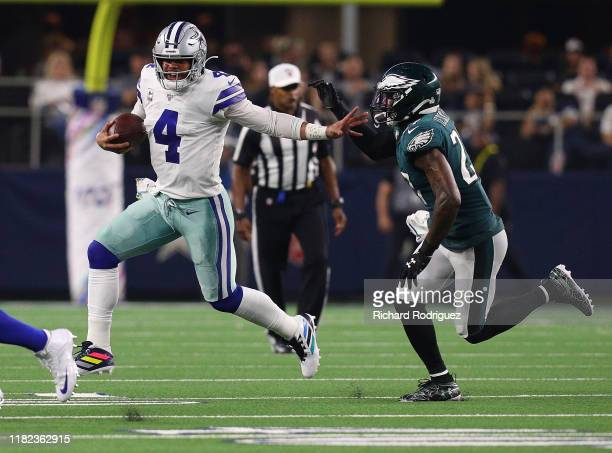 Dak Prescott of the Dallas Cowboys is pursued by Malcolm Jenkins of the Philadelphia Eagles at AT&T Stadium on October 20, 2019 in Arlington, Texas.