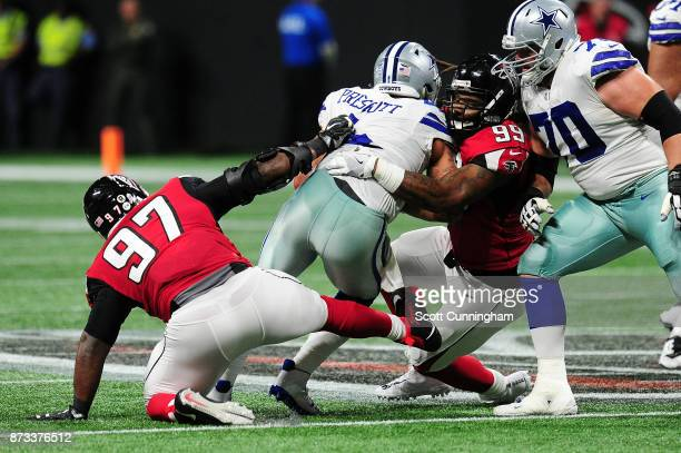 Dak Prescott of the Dallas Cowboys is sacked by Adrian Clayborn of the Atlanta Falcons during the first half at Mercedes-Benz Stadium on November 12,...
