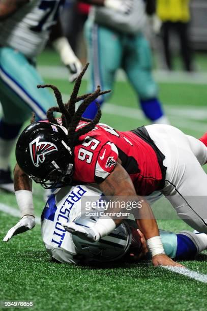 Dak Prescott of the Dallas Cowboys is sacked by Adrian Clayborn of the Atlanta Falcons at MercedesBenz Stadium on November 12 2017 in Atlanta Georgia