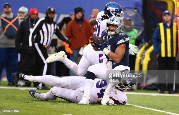 Dak Prescott of the Dallas Cowboys is tackled by Dalvin Tomlinson of the New York Giants during their game at MetLife Stadium on December 10 2017 in...