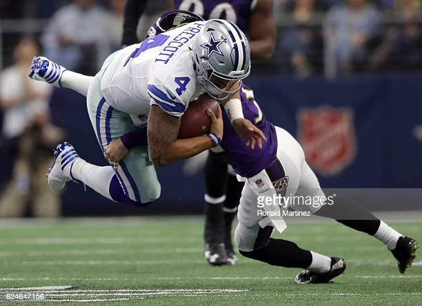 Dak Prescott of the Dallas Cowboys is tackled by Eric Weddle of the Baltimore Ravens during the second quarter of their game at ATT Stadium on...
