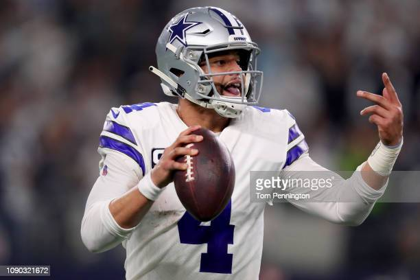 Dak Prescott of the Dallas Cowboys looks for an open receiver against the Seattle Seahawks in the fourth quarter during the Wild Card Round at ATT...