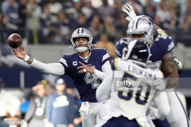 Dak Prescott of the Dallas Cowboys looks for an open receiver against the Los Angeles Rams in the first half at ATT Stadium on December 15 2019 in...