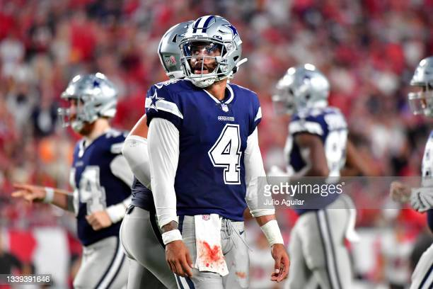 Dak Prescott of the Dallas Cowboys looks on during the fourth quarter against the Tampa Bay Buccaneers at Raymond James Stadium on September 09, 2021...