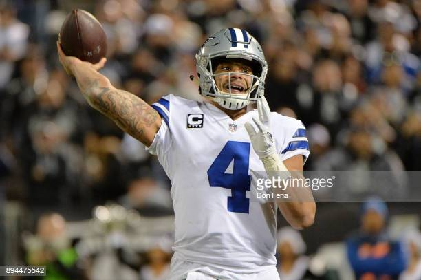 Dak Prescott of the Dallas Cowboys looks to pass against the Oakland Raiders during their NFL game at OaklandAlameda County Coliseum on December 17...