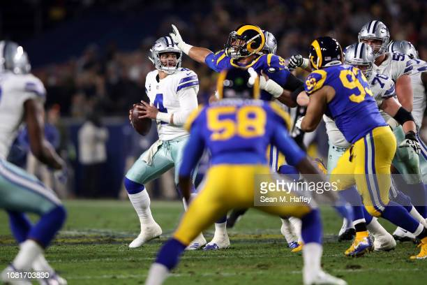 Dak Prescott of the Dallas Cowboys looks to pass in the second quarter against the Los Angeles Rams in the NFC Divisional Playoff game at Los Angeles...