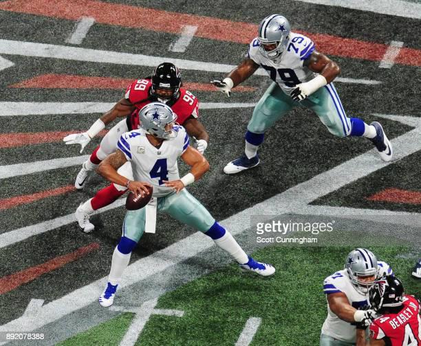 Dak Prescott of the Dallas Cowboys passes despite pressure by Adrian Clayborn of the Atlanta Falcons at MercedesBenz Stadium on November 12 2017 in...