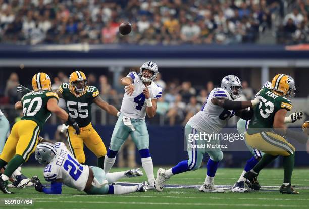 Dak Prescott of the Dallas Cowboys passes the ball against the Green Bay Packers in the first half of football game at ATT Stadium on October 8 2017...