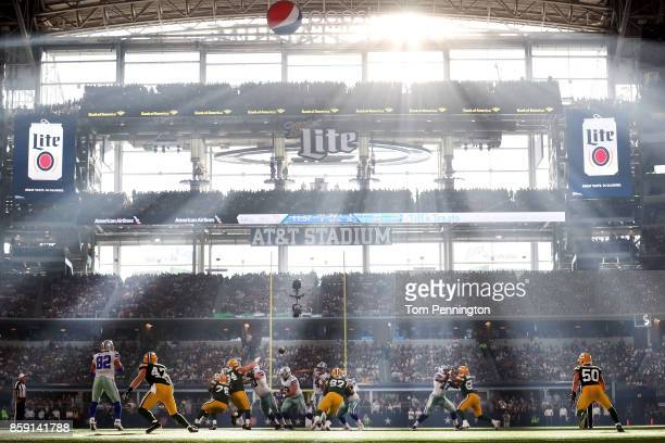 Dak Prescott of the Dallas Cowboys passes the ball to an open receiver against the Green Bay Packers in the third quarter at ATT Stadium on October 8...
