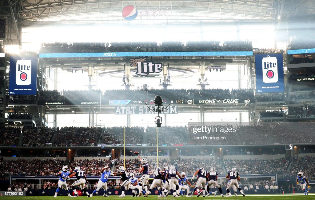 Dak Prescott #4 of the Dallas Cowboys passes the ball to an open receiver against the the Los Angeles Chargers during a Thanksgiving Day game at AT&T Stadium on November 23, 2017 in Arlington, Texas.