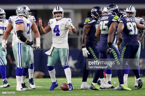 Dak Prescott of the Dallas Cowboys reacts after being sacked by the Seattle Seahawks in the fourth quarter at ATT Stadium on December 24 2017 in...
