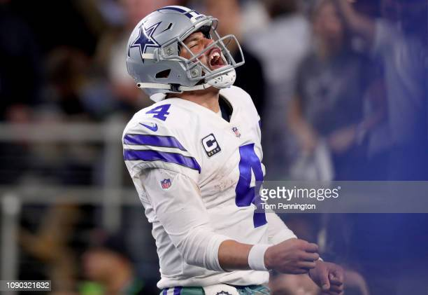 Dak Prescott of the Dallas Cowboys reacts after carrying the ball against the Seattle Seahawks in the fourth quarter during the Wild Card Round at...