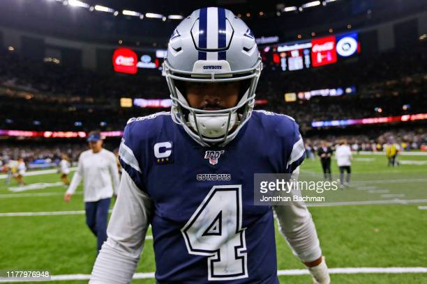 Dak Prescott of the Dallas Cowboys reacts after losing a game against the New Orleans Saints at the Mercedes Benz Superdome on September 29, 2019 in...