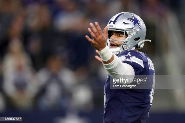 Dak Prescott of the Dallas Cowboys reacts after throwing an incomplete pass against the Minnesota Vikings in the fourth quarter at AT&T Stadium on...