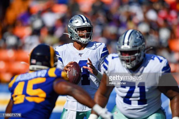 Dak Prescott of the Dallas Cowboys reads the Los Angeles Rams defense during the preseason game at Aloha Stadium on August 17 2019 in Honolulu Hawaii