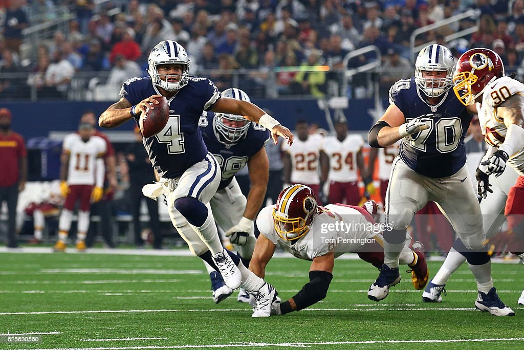 Dak Prescott #4 of the Dallas Cowboys rolls out to pass during the second quarter against the Washington Redskins at AT&T Stadium on November 24, 2016 in Arlington, Texas.