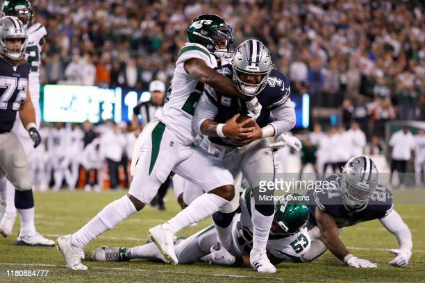 Dak Prescott of the Dallas Cowboys runs for a touchdown against Marcus Maye of the New York Jets during the fourth quarter at MetLife Stadium on...