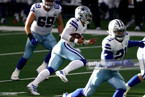 Dak Prescott of the Dallas Cowboys runs the ball before sustaining an ankle injury against the New York Giants during the third quarter at AT&T...