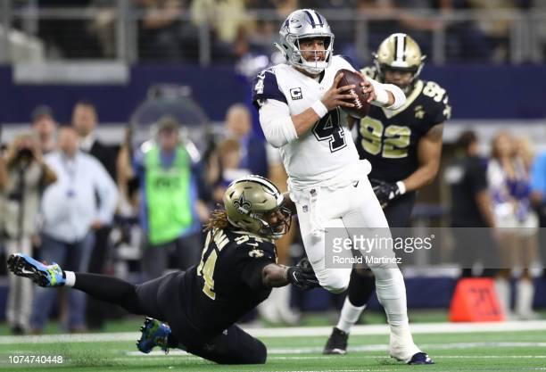 Dak Prescott of the Dallas Cowboys runs the ball Cameron Jordan of the New Orleans Saints in the second quarter at ATT Stadium on November 29 2018 in...