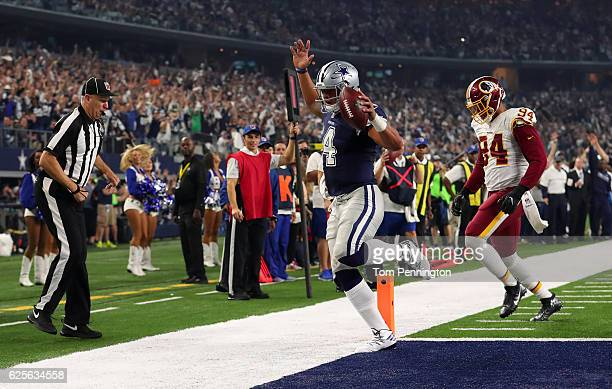 Dak Prescott of the Dallas Cowboys rushes for a touchdown during the fourth quarter against the Washington Redskins at ATT Stadium on November 24...