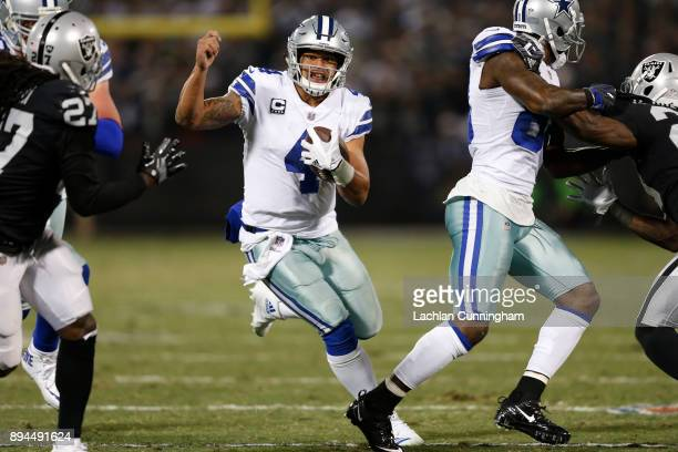 Dak Prescott of the Dallas Cowboys rushes with the ball against the Oakland Raiders during their NFL game at OaklandAlameda County Coliseum on...