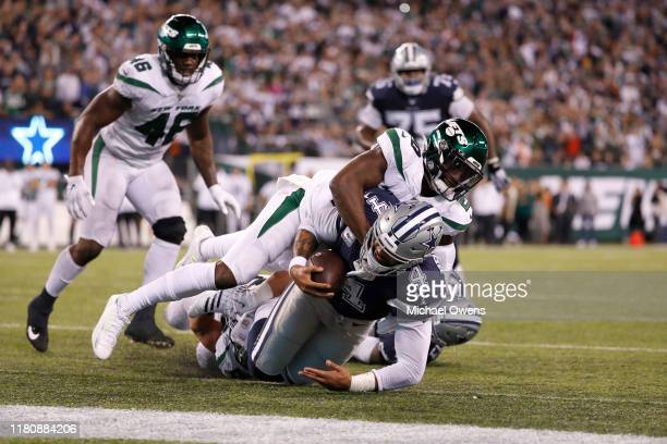 Dak Prescott of the Dallas Cowboys scores a touchdown against Marcus Maye of the New York Jets during the fourth quarter at MetLife Stadium on...
