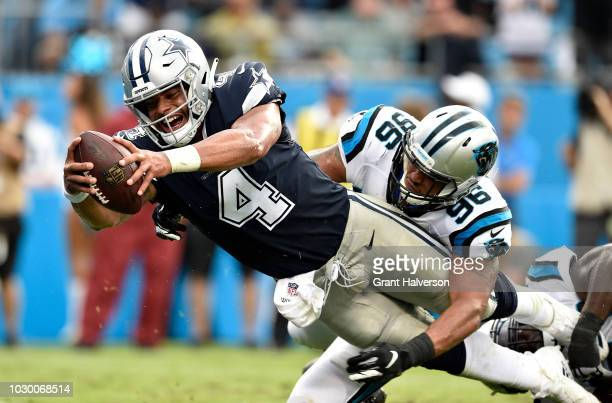 Dak Prescott of the Dallas Cowboys scores a two point conversion against the Carolina Panthers in the fourth quarter during their game at Bank of...