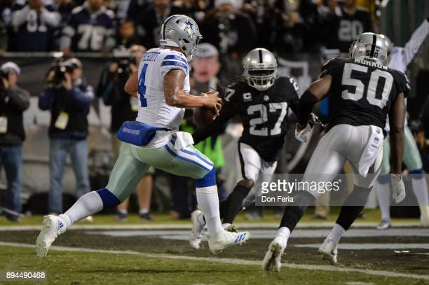 Dak Prescott of the Dallas Cowboys scores on a fiveyard run against the Oakland Raiders during their NFL game at OaklandAlameda County Coliseum on...