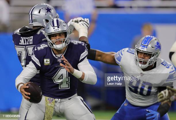 Dak Prescott of the Dallas Cowboys scrambles as Trey Flowers of the Detroit Lions gives chase during the first quarter of the game at Ford Field on...