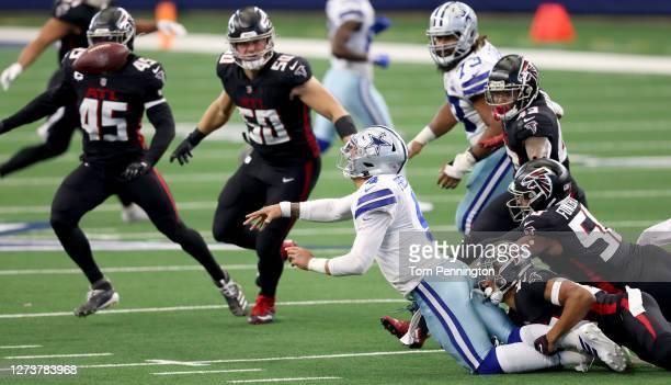 Dak Prescott of the Dallas Cowboys scrambles under pressure from A.J. Terrell of the Atlanta Falcons and Dante Fowler Jr. #56 of the Atlanta Falcons...