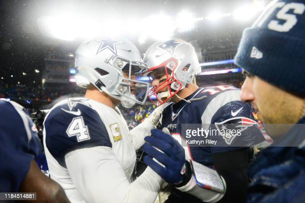 Dak Prescott of the Dallas Cowboys shakes hands with Tom Brady of the New England Patriots following the game at Gillette Stadium on November 24 2019...