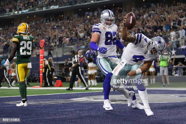 Dak Prescott of the Dallas Cowboys spikes the ball in front of Jason Witten of the Dallas Cowboys after a fourth quarter touchdown against the Green...