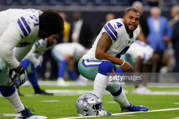 Dak Prescott of the Dallas Cowboys stretches before the preseason game against the Houston Texans at NRG Stadium on August 30 2018 in Houston Texas