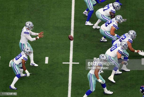 Dak Prescott of the Dallas Cowboys takes a snap in the first quarter against the New York Giants at AT&T Stadium on September 08, 2019 in Arlington,...