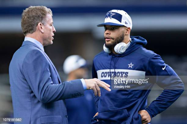 Dak Prescott of the Dallas Cowboys talks with Troy Aikman before a game against the Washington Redskins at ATT Stadium on November 22 2018 in...
