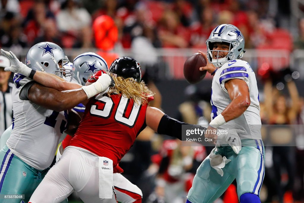Dak Prescott #4 of the Dallas Cowboys throws a pass during the first half against the Atlanta Falcons at Mercedes-Benz Stadium on November 12, 2017 in Atlanta, Georgia.