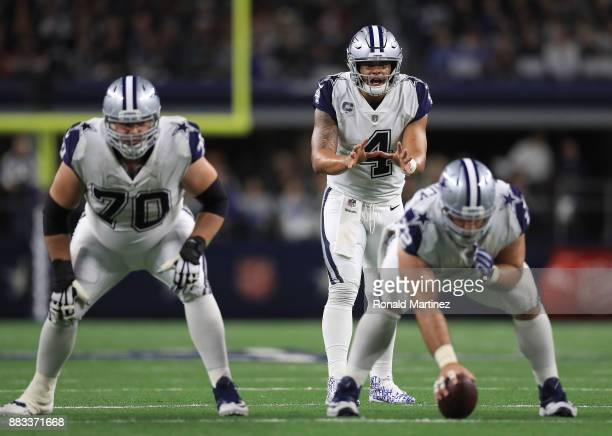Dak Prescott of the Dallas Cowboys waits for the snap in the first half of a football game against the Washington Redskins at ATT Stadium on November...