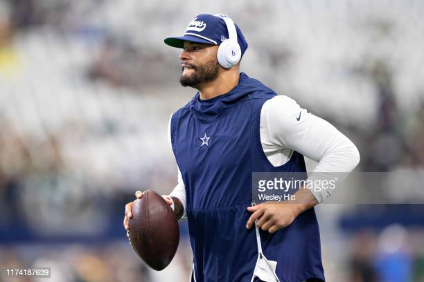 Dak Prescott of the Dallas Cowboys warms up before a game against the Green Bay Packers at AT&T Stadium on October 6, 2019 in Arlington, Texas.