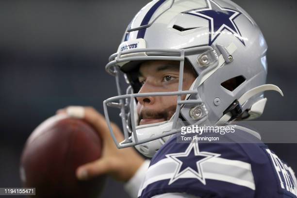 Dak Prescott of the Dallas Cowboys works through pregame warm up before taking on the Los Angeles Rams at ATT Stadium on December 15 2019 in...