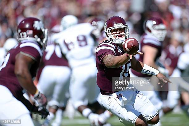 Dak Prescott of the Mississippi State Bulldogs flips the ball to Josh Robinson during the first quarter of a game against the Texas AM Aggies at...