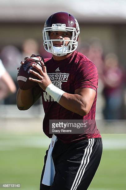 Dak Prescott of the Mississippi State Bulldogs participates in warmups prior to a game against the Texas AM Aggies at Davis Wade Stadium on October 4...